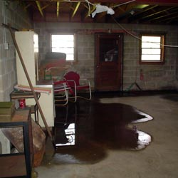 A flooded basement showing groundwater intrusion in St. Louis