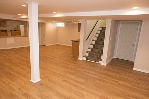 a remodeled basement with the total basement finishing system