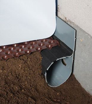 Closeup of a crawl space drainage system installed in Charleston