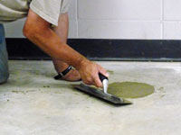 Repairing the cored holes in the concrete slab floor with fresh concrete and cleaning up the St. Peters home.
