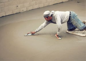 smoothing out the grout in a slab releveling project in Belleville