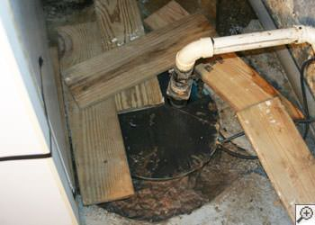 An ugly, clogged sump pump system in Belleville, Illinois & Missouri
