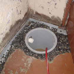 Installing a sump in a sump pump liner in a St. Charles home