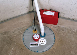 A sump pump system with a battery backup system installed in Poplar Bluff