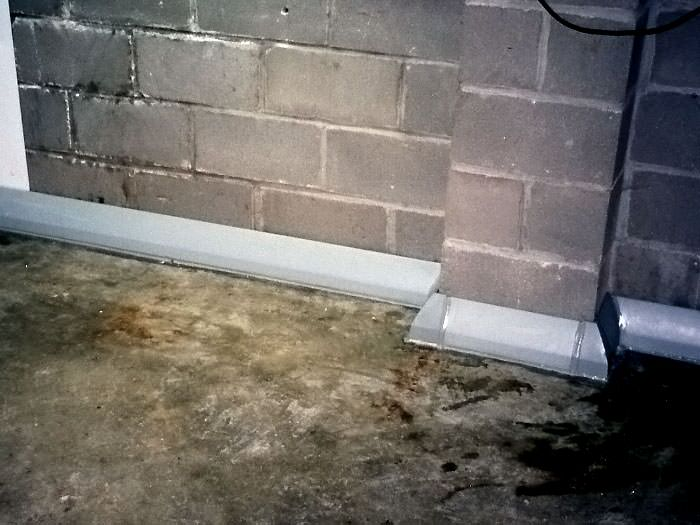 Baseboard basement drain pipe system in greater st louis - Interior basement drainage systems ...