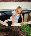 A child crawling out of an egress entryway window system in Belleville.